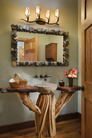 Interior, vertical, powder room with granite sink and redwood burwoodl top and juniper base, Bolduc residence, Woolwich, Maine; PrecisionCraft Log & Timber Homes
