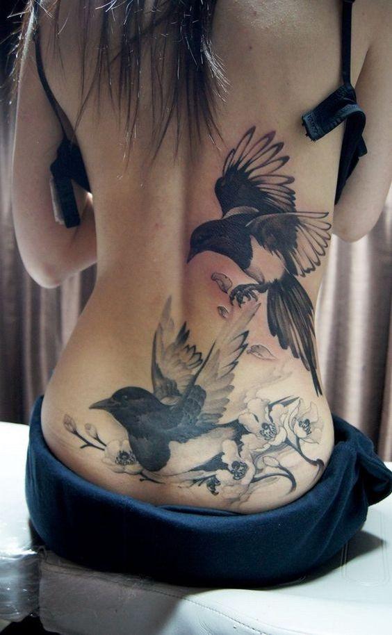 татуировка фото на пояснице