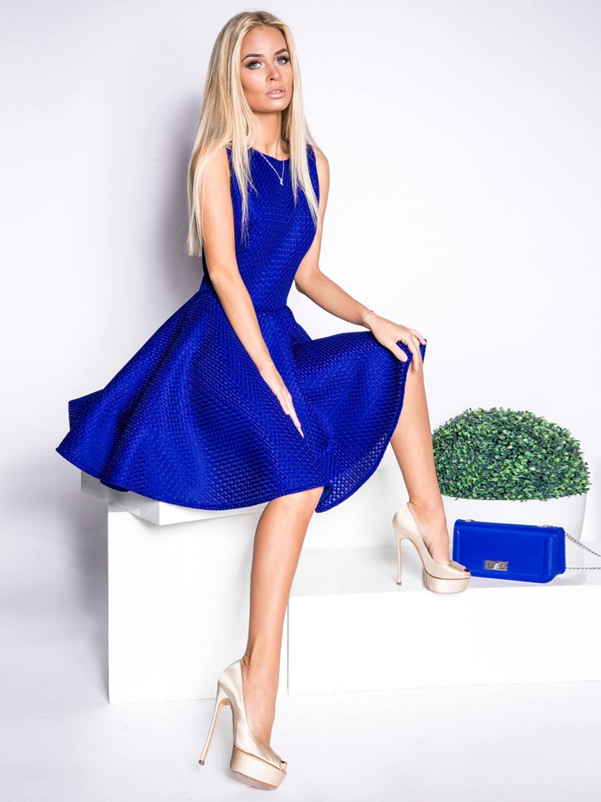 Lottie moss displays her dress flair in a terracotta mini dress